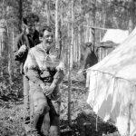 Edgar Abbott cutting Frank Swannell's hair; Nechako survey of 1908