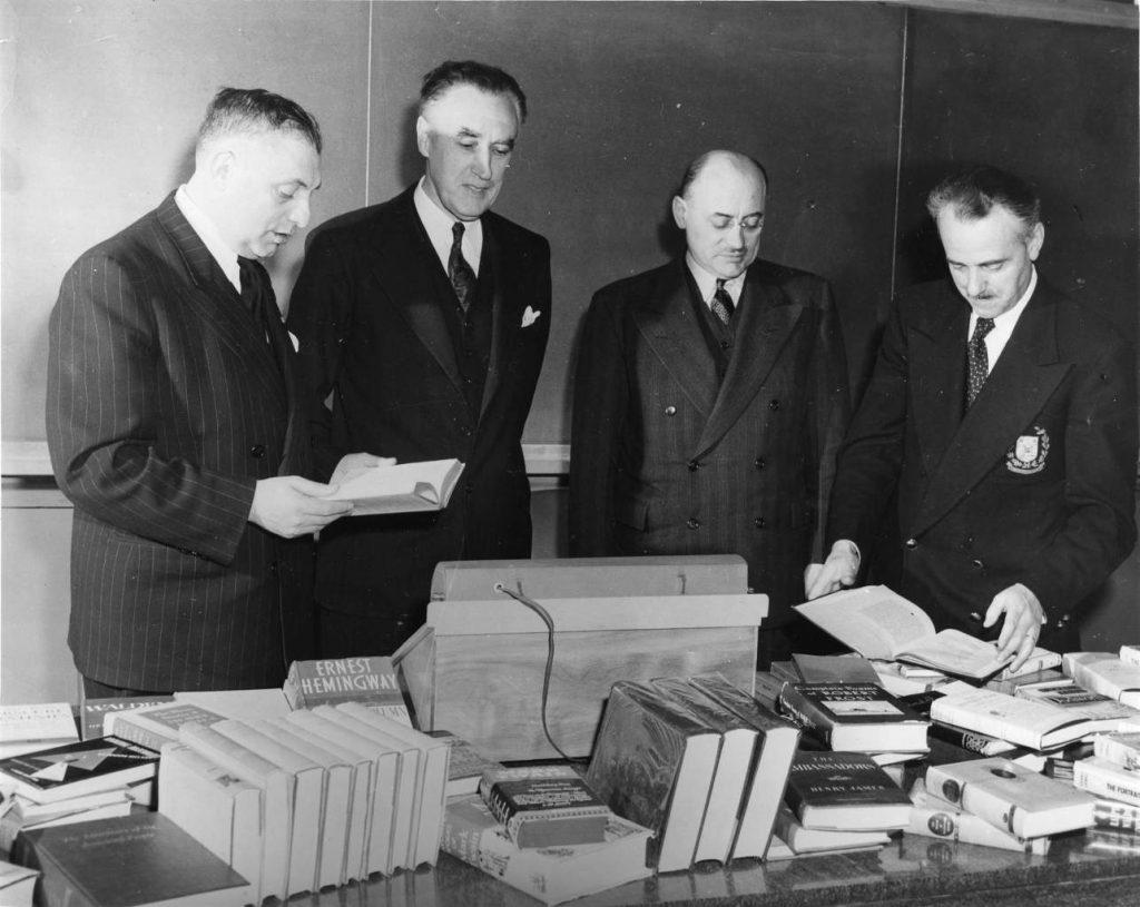 MM. Thomas Greenwood, Richard P. Butrick, Marcel Faribault et Raymond Tanghe. Archives UdeM, D0037/1fp,04745.